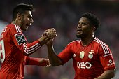 Benfica's defender Eliseu Santos celebrates with Benfica's Argentine midfielder Eduardo Salvio after scoring during the Portuguese league football...