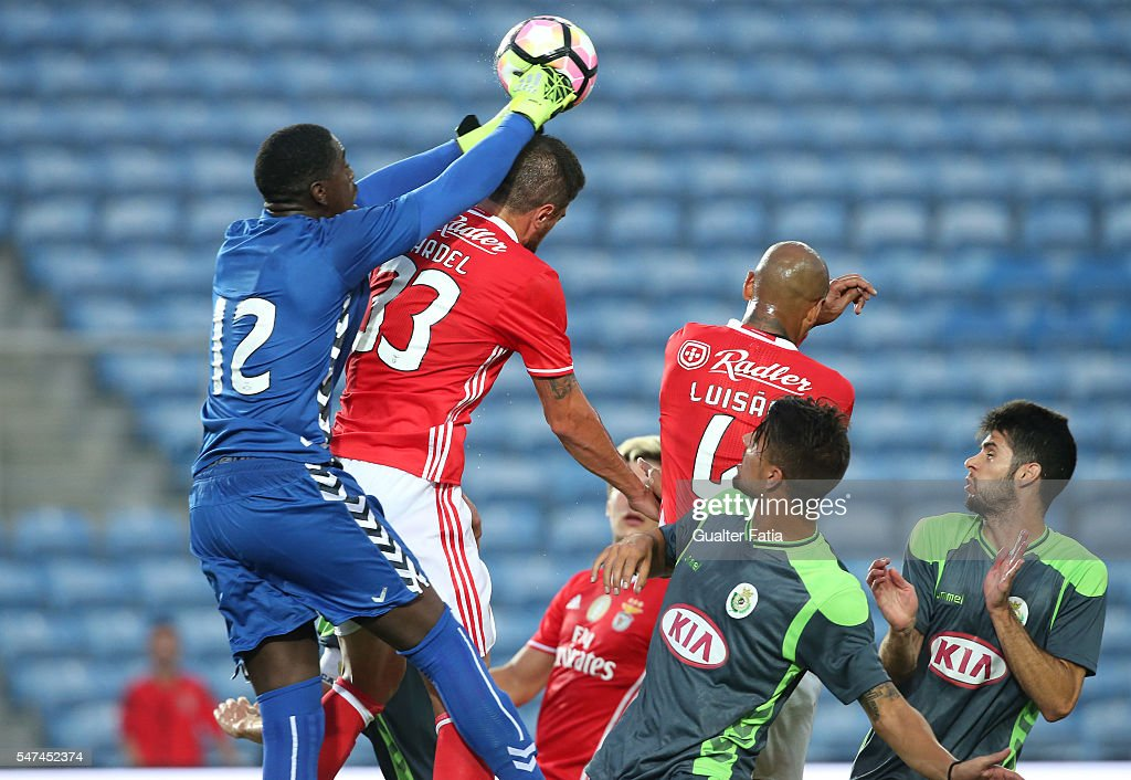 SL Benfica's defender from Brazil Jardel with Vitoria Setubal's goalkeeper Bruno Varela in action during the Algarve Football Cup Pre Season Friendly match between SL Benfica and Vitoria Setubal at Estadio do Algarve on July 14, 2016 in Faro, Portugal.