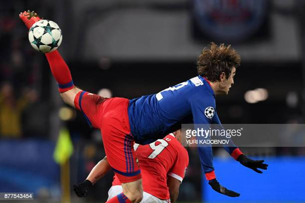TOPSHOT Benfica's defender from Portugal Eliseu and CSKA Moscow's defender from Russia Mario Fernandes vie for the ball during the UEFA Champions...
