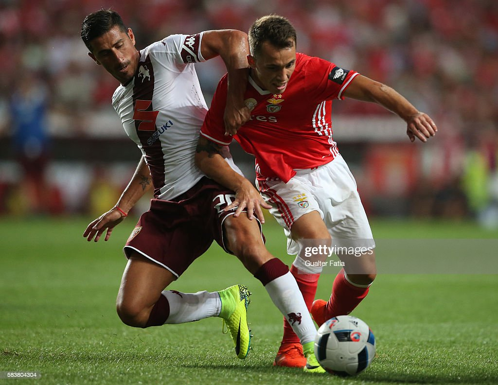 SL Benfica's defender from Spain Alex Grimaldo tackled by Torino's midfielder Giuseppe Vives during the Eusebio Cup match between SL Benfica and Torino at Estadio da Luz on July 27, 2016 in Lisbon, Portugal.