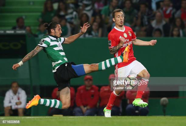 Benfica's defender from Spain Alex Grimaldo with Sporting CP's defender Ezequiel Schelotto from Argentina in action during the Primeira Liga match...