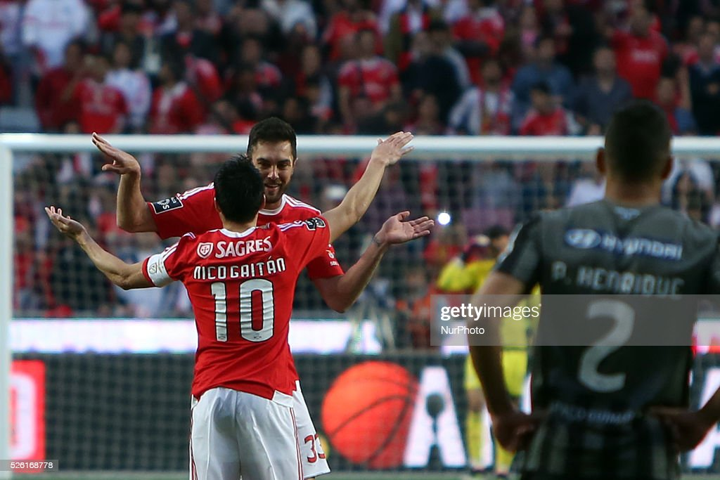 Benfica's defender <a gi-track='captionPersonalityLinkClicked' href=/galleries/search?phrase=Jardel+-+Fu%C3%9Fballspieler+-+Innenverteidiger+-+Jahrgang+1986&family=editorial&specificpeople=12802586 ng-click='$event.stopPropagation()'>Jardel</a> celebrates with Benfica's midfielder Nicols Gaitan (10) after scoring during the Portuguese League football match SL Benfica vs Vitoria Guimaraes SC at Luz stadium in Lisbon on April 29, 2016.