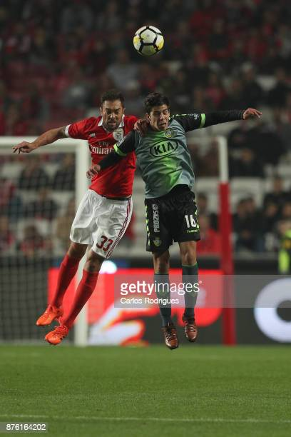 Benfica's defender Jardel Vieira from Brasil vies with Setubal's midfielder Andre Sousa from Portugal for the ball possession during the match...