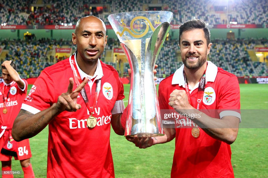 Benfica's defender Luisao from Brasil (L) and Benfica's defender Jardel Vieira from Brasil (R) with Portuguese Super Cup trophy after the match between SL Benfica and VSC Guimaraes at Estadio Municipal de Aveiro on August 05, 2017 in Lisbon, Portugal.