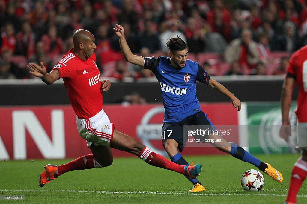 Benfica's defender Luisao tries to stop Monaco's forward Yannick Ferreira-Carrasco during the UEFA Champions League match between SL Benfica and AS Monaco at the Estadio da Luz on November 4, 2014 in Lisbon, Portugal.