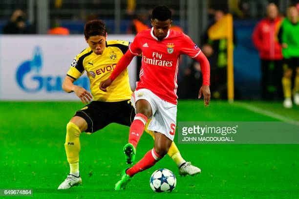 Benfica's defender Nelson Semedo and Dortmund's Japanese midfielder Shinji Kagawa vie for the ball during the UEFA Champions League Round of 16...