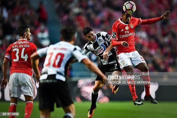 Benfica's defender Nelson Semedo heads the ball with Boavista's midfielder Renato Santos during the Portuguese league football match SL Benfica vs...