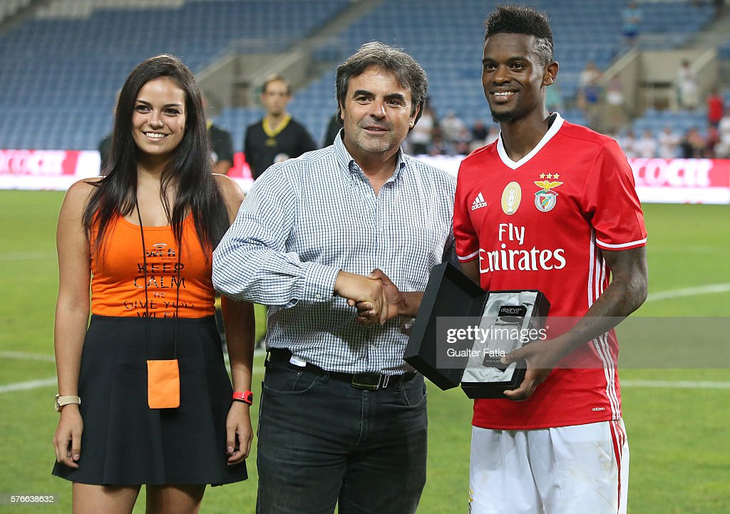 SL Benfica's defender Nelson Semedo (R) receives the best player of the tournament award at the end of the Algarve Football Cup Pre Season Friendly match between SL Benfica and Derby County at Estadio do Algarve on July 16, 2016 in Faro, Portugal.
