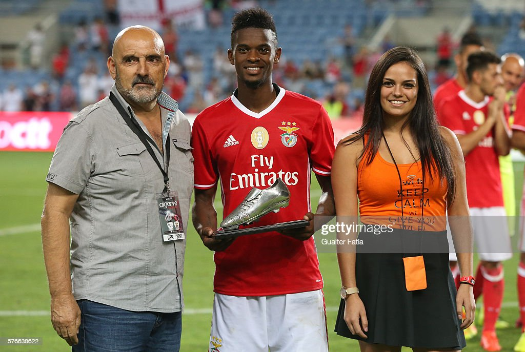 SL Benfica's defender Nelson Semedo (C) receives the best scorer of the tournament award at the end of the Algarve Football Cup Pre Season Friendly match between SL Benfica and Derby County at Estadio do Algarve on July 16, 2016 in Faro, Portugal.