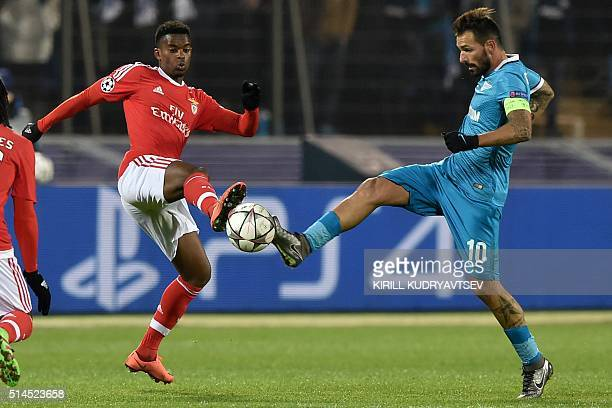 Benfica's defender Nelson Semedo vies for the ball with Zenit's Portuguese midfielder Danny during the secondleg round of 16 UEFA Champions League...