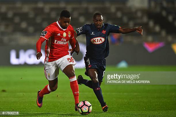 Benfica's defender Nelson Semedo vies with Belenenses' Bissau Guinean forward Gerso Fernandes during the Portuguese league football match between OS...