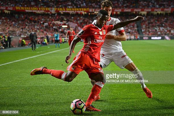 Benfica's defender Nelson Semedo vies with Braga's Montenegrin midfielder Nikola Vukcevic during the Portuguese league football match SL Benfica vs...
