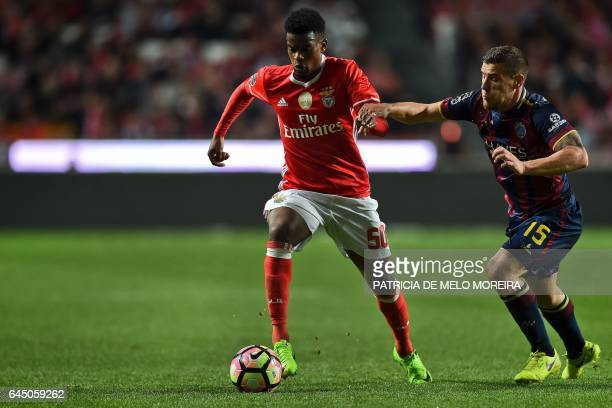 Benfica's defender Nelson Semedo vies with Chaves' midfielder Tiba da Silva during the Portuguese league football match SL Benfica vs GD Chaves at...