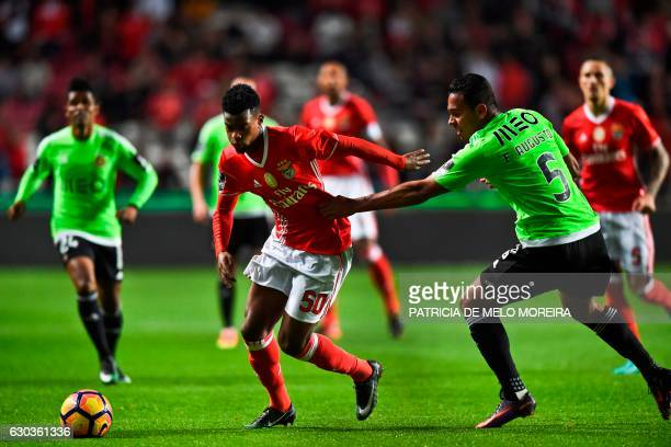 Benfica's defender Nelson Semedo vies with Rio Ave's Brazilian midfielder Filipe Augusto during the Portuguese league football match SL Benfica vs...