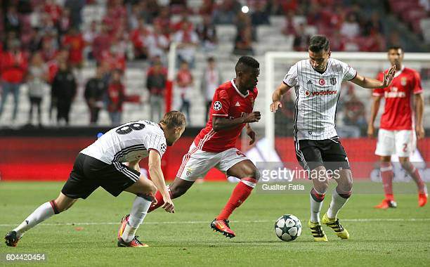 Benfica's defender Nelson Semedo with Besiktas JK's midfielder Oguzhan Ozyakup and Besiktas JK's defender Caner Erkin in action during the UEFA...