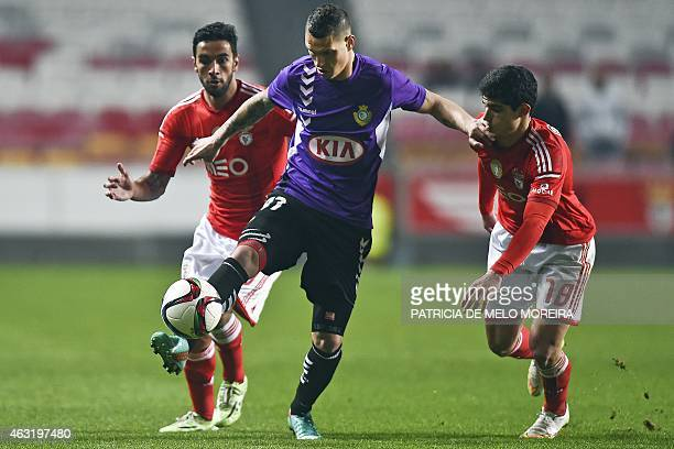 Benfica's defender Silvo Sa Perreira and Benfica's forward Goncalo Guedes fight for the ball with Setubal's forward Jose Branco 'Zequinha' during the...