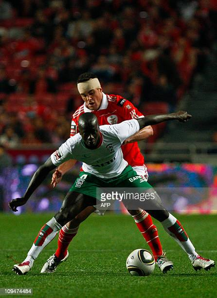 Benfica's defense Fabio Faria fights for the ball with Maritmo's senegalese foward Papa Diawara 'Baba' during their Portuguese League football match...