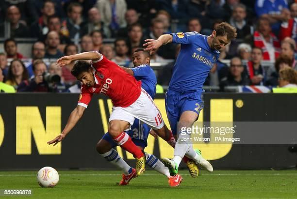 Benfica's Eduardo Salvio battles for the ball with Chelsea's Branislav Ivanovic and Ashley Cole