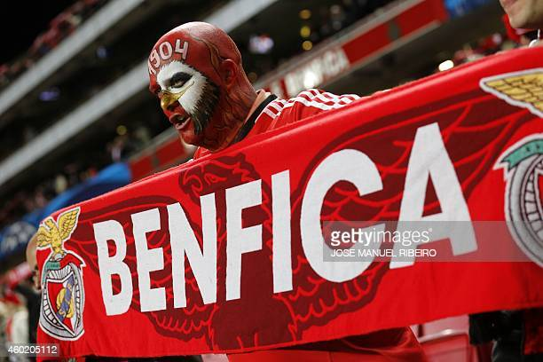A Benfica's fan holds a scarf of the club prior to the UEFA Champions League football match Group C SL Benfica vs Bayer 04 Leverkusen at Luz stadium...