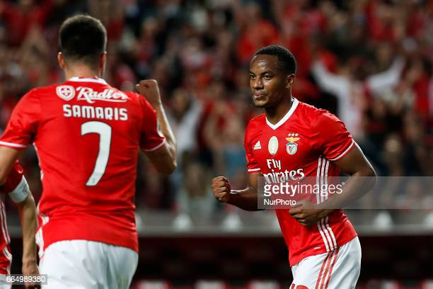 Benfica's forward Andre Carrillo celebrates his goal with Benfica's midfielder Andreas Samaris during the Portuguese Cup semifinal second leg...