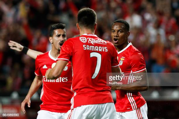 Benfica's forward Andre Carrillo celebrates his goal with Benfica's midfielder Andreas Samaris and Benfica's defender Andre Almeida during the...