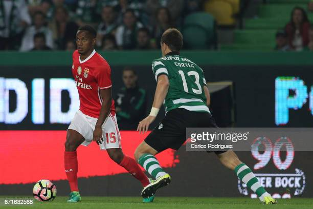 Benfica's forward Andre Carrillo from Paraguay tries to escape Sporting CP's defender Sebastian Coates from Uruguay during the Sporting CP v SL...