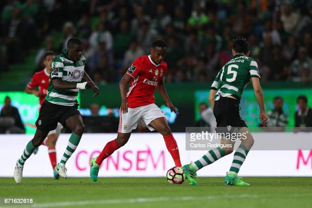 Benfica's forward Andre Carrillo from Paraguay tries to escape Sporting CP's midfielder William Carvalho from Portugal and Sporting CP's defender...