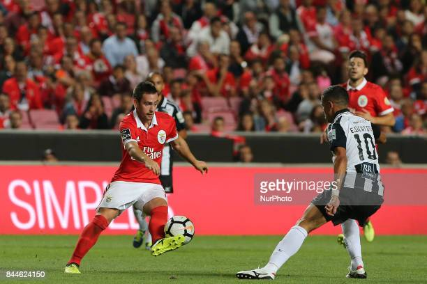 Benficas forward Andrija Zivkovic from Serbia and Portimonenses midfielder Ewerton from Brazil during the Premier League 2017/18 match between SL...