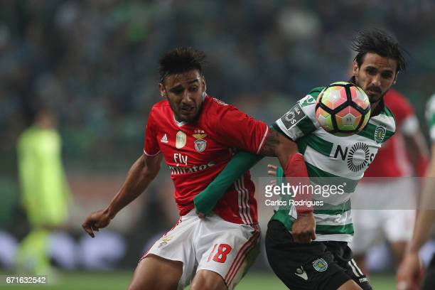 Benfica's forward Eduardo Salvio from Argentina vies with Sporting CP's forward Bryan Ruiz from Costa Rica during the Sporting CP v SL Benfica...