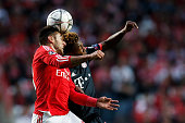Benfica's forward Eduardo Salvio heads for the ball with Bayern Munich's midfielder David Alaba during the Champions League football match between SL...