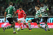 Benfica's forward Eduardo Salvio tries to escape Sporting's defender Sebastian Coates during the match between Sporting CP and SL Benfica for the...