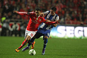 Benfica's forward Eduardo Salvio vies with Porto's midfielder Hector Herrera during the match between SL Benfica and FC Porto for the portuguese...