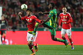 Benfica's forward Eduardo Salvio vies with Tondela's midfielder Helder Tavares during the match between SL Benfica and CD Tondela for the portuguese...