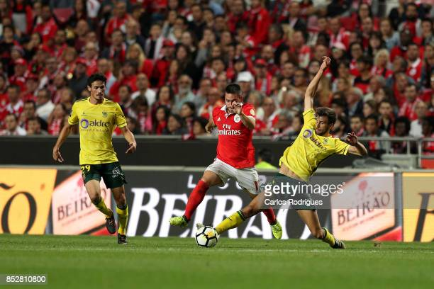 Benfica's forward Franco Cervi from Argentina vies with FC Pacos de Ferreira defender Rui Correia from Portugal for the ball possession during the...