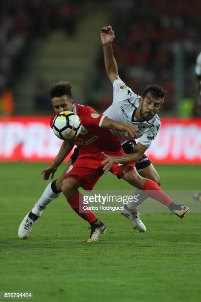 Benfica's forward Franco Cervi from Argentina vies with Guimaraes's defender Joao Aurelio from Portugal during the match between SL Benfica and VSC...