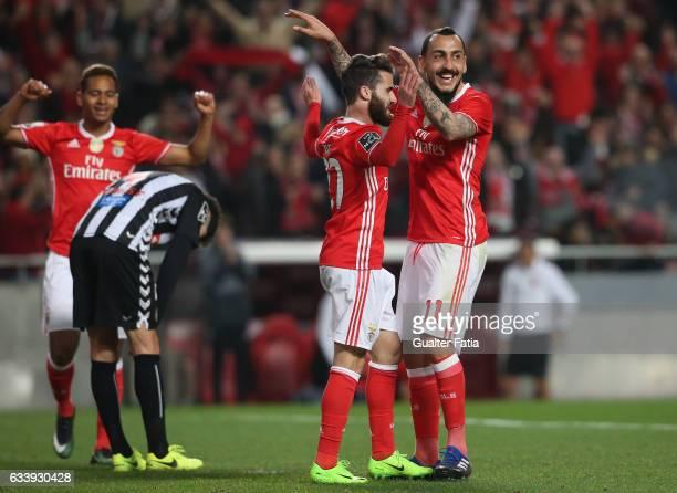 Benfica's forward from Greece Kostas Mitroglou celebrates with teammate SL Benfica's forward Rafa Silva after scoring a goal during the Primeira Liga...