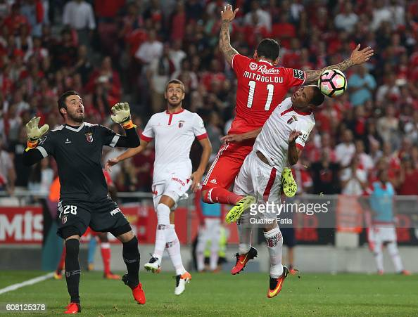 Benfica's forward from Greece Kostas Mitroglou tackled by SC Braga's Brazilian defender Baiano during the Primeira Liga match between SL Benfica and...