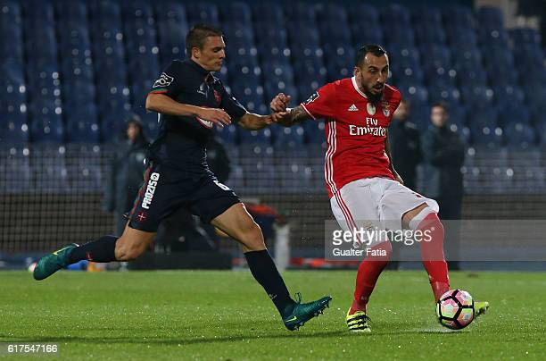 Benfica's forward from Greece Kostas Mitroglou with Belenenses's midfielder Joao Palhinha from Portugal in action during the Primeira Liga match...
