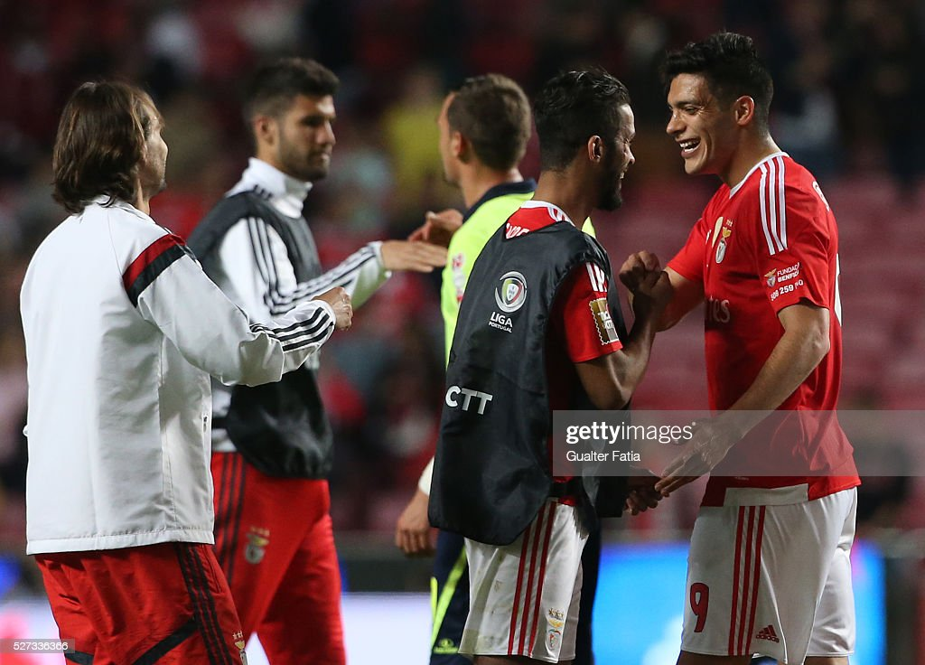 SL Benfica's forward from Mexico Raul Jimenez (R) celebrates the victory with teammate SL Benfica's midfielder from morocco Carcela at the end of the Taca CTT match between SL Benfica and SC Braga at Estadio da Luz on May 2, 2016 in Lisbon, Portugal.