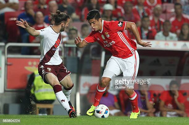 Benfica's forward from Mexico Raul Jimenez with Torino's midfielder Gaston Alexis Silva in action during the Eusebio Cup match between SL Benfica and...