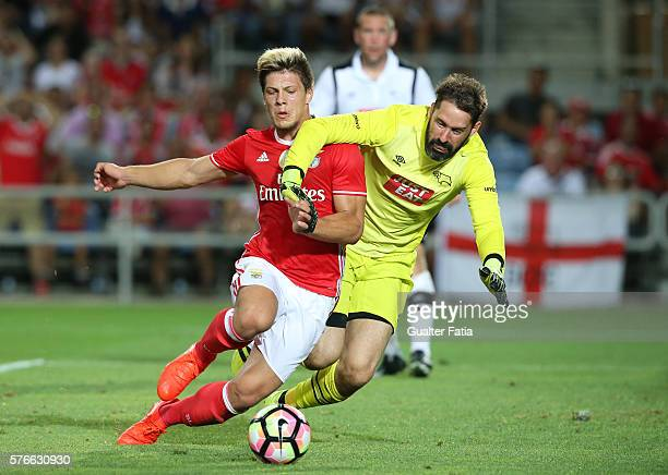 Benfica's forward from Serbia Luka Jovic with Derby County's goalkeeper Carson in action during the Algarve Football Cup Pre Season Friendly match...