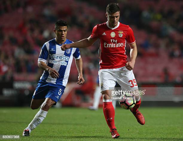 Benfica's forward from Serbia Luka Jovic with Vizela«s midfielder Alex Porto from Brazil in action during the Primeira Liga match between SL Benfica...