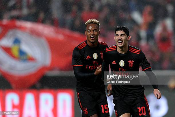 Benfica's forward Goncalo Guedes from Portugal celebrates scoring Benfica sixth goal with Benfica's forward Andre Carrillo from Paraguayduring the SL...