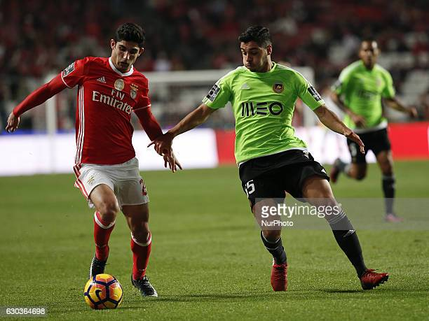 Benfica's forward Goncalo Guedes vies for the ball with Rio Ave's defender Rafa Soares during Premier League 2016/17 match between SL Benfica vs Rio...