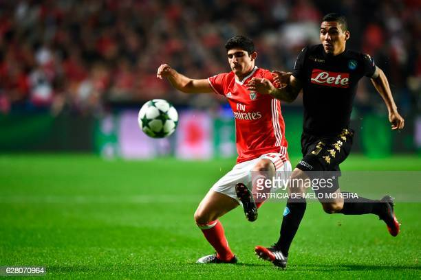 CORRECTION Benfica's forward Goncalo Guedes vies with Napoli's Brazilian midfielder Allan during the UEFA Champions League Group B football match SL...