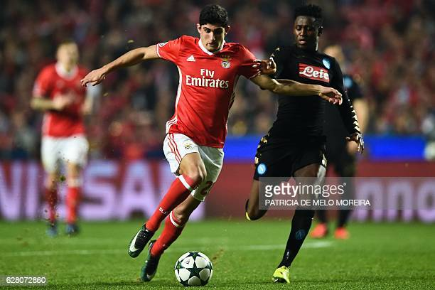 Benfica's forward Goncalo Guedes vies with Napoli's Guinean midfielder Amadou Diawara during the UEFA Champions League Group B football match SL...