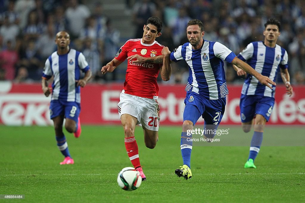 Benfica's forward Goncalo Guedes vies with Porto's defender Layun during the match between FC Porto and SL Benfica for the Portuguese Primeira Liga at Estadio do Dragao on September 20, 2015 in Porto, Portugal.