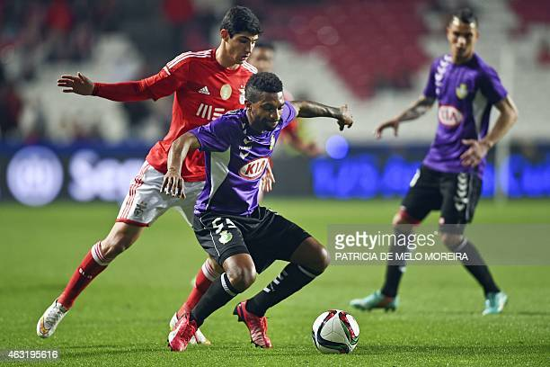 Benfica's forward Goncalo Guedes vies with Setubal's defender Helder Cabral during the Portuguese League Cup semifinal football match SL Benfica vs...