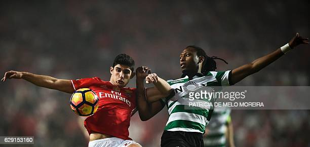 Benfica's forward Goncalo Guedes vies with Sporting's defender Ruben Semedo during the Portuguese league football match SL Benfica vs Sporting CP at...