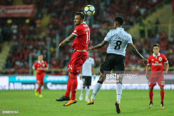 Benficas forward Haris Seferovic from Switzerland and Vitoria Guimaraes defender Bongani Zungu from South Africa during the Candido Oliveira Super...